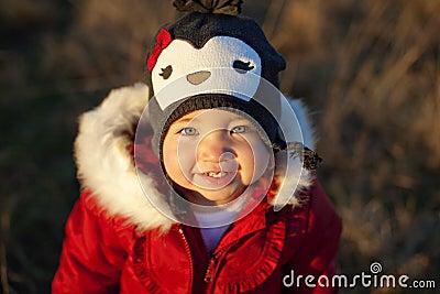 Cute girl in penguin hat smiling