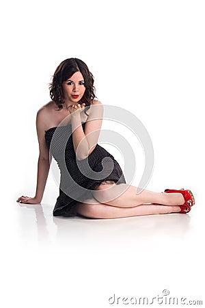 Cute girl in pin-up pose
