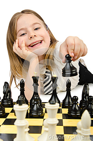 Cute girl playing chess