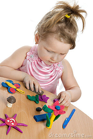Cute girl playing with color play plasticine
