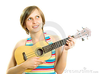 Cute girl playing an ukulele