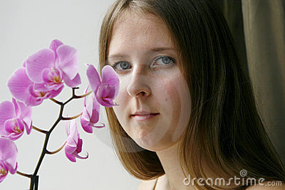 Cute girl with a purple orchid