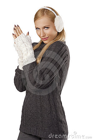 Cute girl ready for the winter cold day standing
