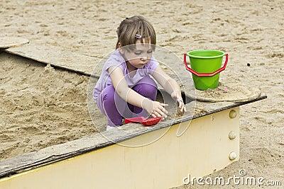 Cute girl at sandbox