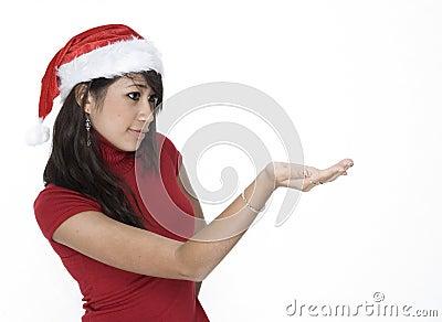 Cute Girl In Santa Hat Holding...