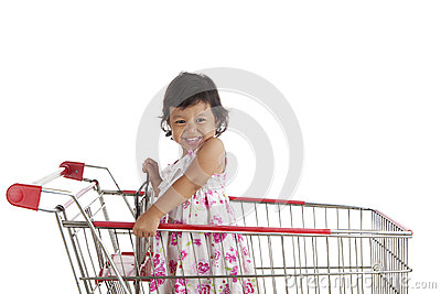 Cute girl on shopping cart