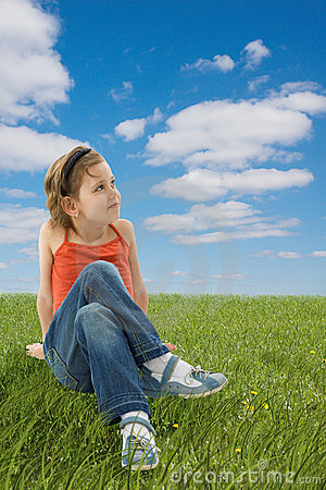 Free Cute Girl Sitting On The Green Grass Stock Photo - 5451630