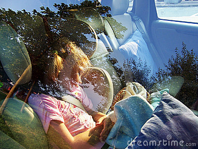 Cute girl sleeping in car