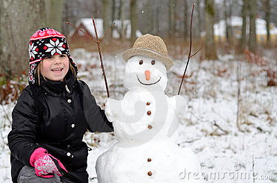 Cute girl with snowman