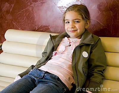 Cute girl on sofa.