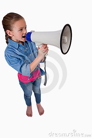 A cute girl speaking through a megaphone