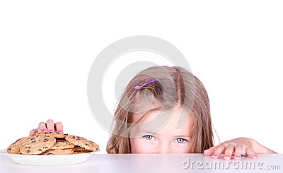 A cute girl steals cookies