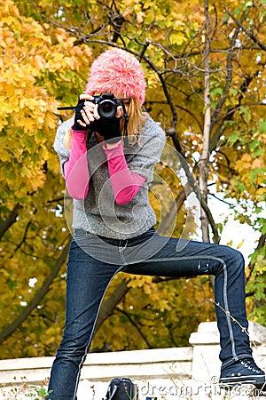 Cute girl taking a photograph