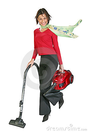 Cute girl vacuuming