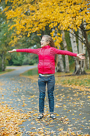Cute girl walking in the autumn park