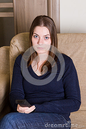 Cute girl watching TV at home Stock Photo