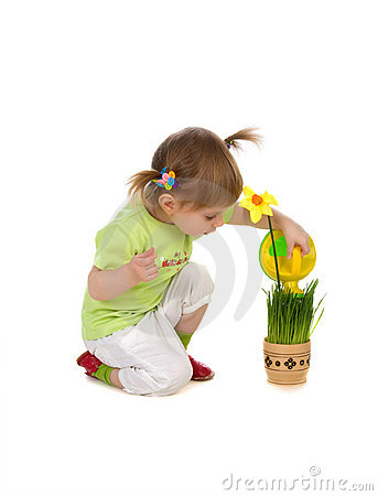 Cute girl watering the flower