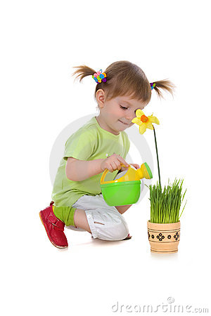 Cute girl watering flower