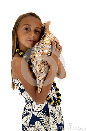 Free Cute Girl Wearing A Tropical Dress And Holding A Large Seashell Stock Photography - 44986702
