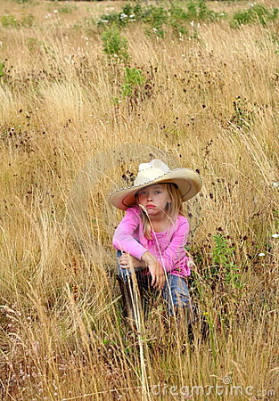 Cute girl wearing a large hat.