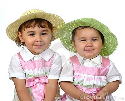 Cute girls, sisters side-by-side