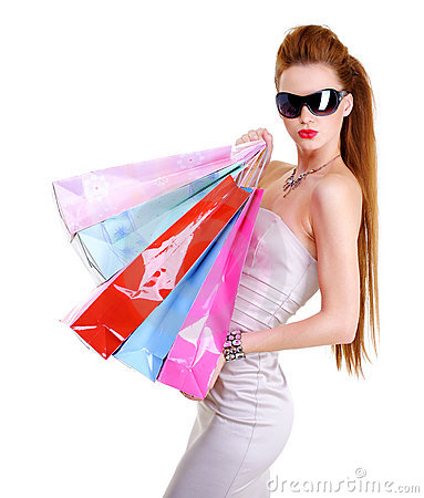 Cute glamour young caucasian woman with purchases