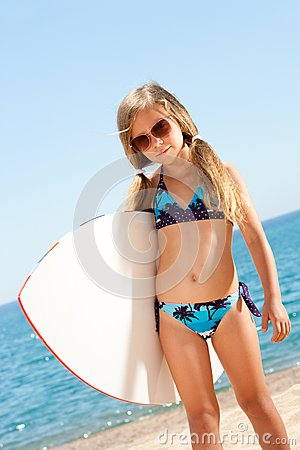 Free Cute Gril Ready To Go Surfing. Royalty Free Stock Photo - 25729565