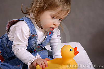 Cute handicapped girl with toy