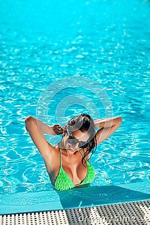 Cute happy bikini woman with nice breast in swimming pool