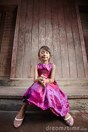Cute and happy little Asian girl smiling at camera