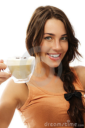 Cute happy woman with a cup of cappuccino coffee