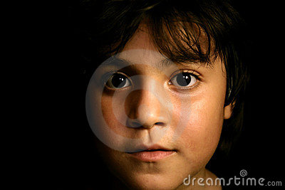 Cute hispanic young child looking foward