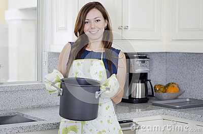 Cute housewife cooking dinner