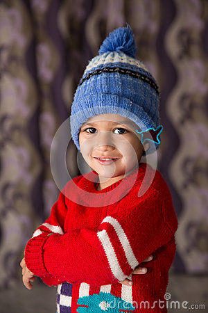 Free Cute Indian Kid Striking A Pose In Winter Wear With A Cute Smile Stock Image - 66390921