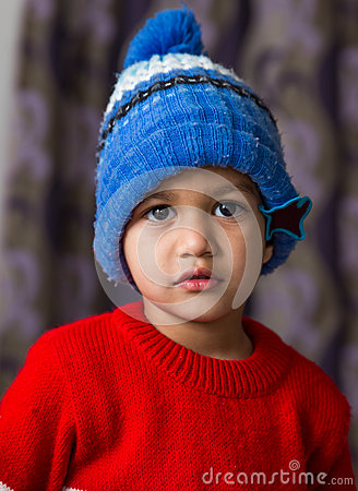 Free Cute Indian Kid Striking A Pose In Winter Wear With A Cute Smile Royalty Free Stock Images - 66393509