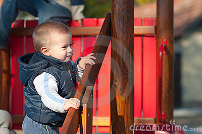 Cute infant boy smiling on the playground