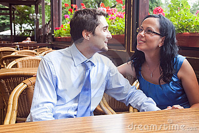 Cute joyful couple at restaurant table