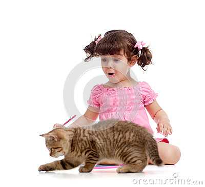 Cute kid and cat kitten playing with pencils
