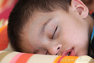 Cute kid in deep sleep
