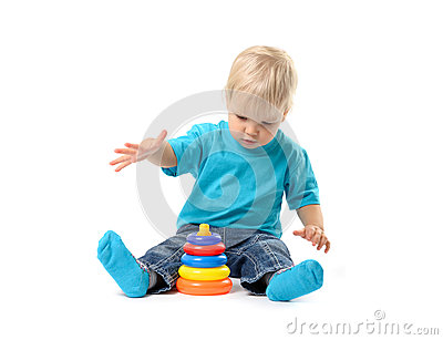 Cute kid girl playing with educational toy