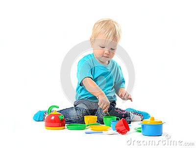 Cute kid girl playing with toy