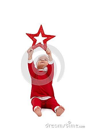 Free Cute Kid In Santa Costume With Big Star Stock Image - 21771921