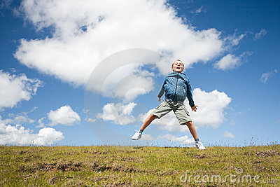 Cute kid jumping for joy