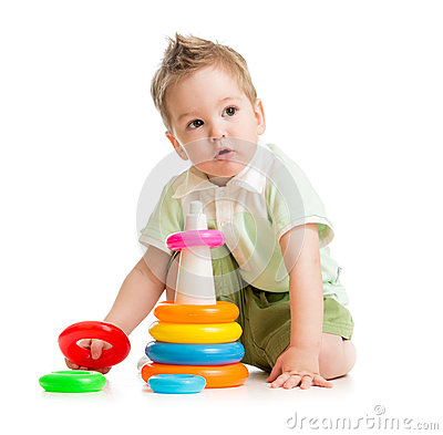 Cute kid playing colorful tower