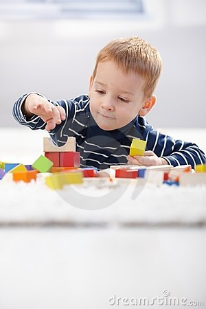 Cute kid playing on floor at home