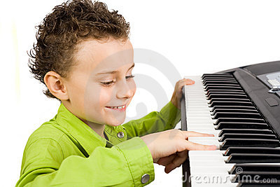 Cute kid playing piano