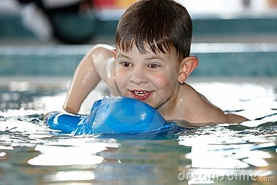 Cute kid playing at swimming pool