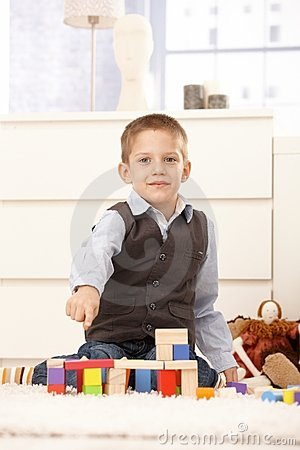 Cute kid proud of building toys