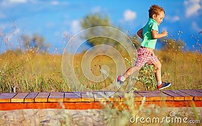 Cute kid running the field