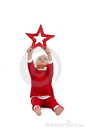 Cute kid in santa costume with big star